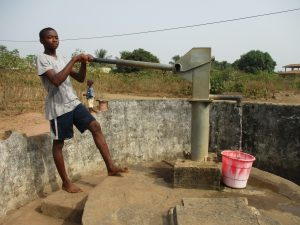 The Water Project:  Boy Collecting Water