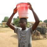 The Water Project: Lungi, Thomossoh, #24 Thullah Street -  Boy Carrying Water