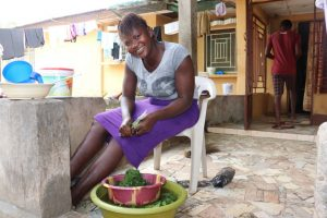 The Water Project:  Girl Slicing Potato Leaves