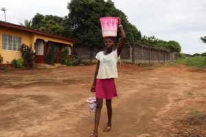 The Water Project:  Young Carrying Water