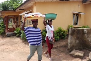 The Water Project:  Young Girls Selling Food Stuff For Domestic Use