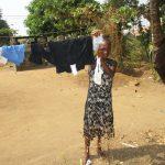 The Water Project: Lungi, Mahera, #5 MacAuley Street -  Girl Hanging Clothe On Clothe Line