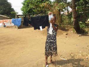 The Water Project:  Girl Hanging Clothes On The Line