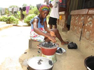 The Water Project:  Lady Setting Fire For Cooking