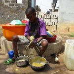 The Water Project: Lungi, Mahera, #5 MacAuley Street -  Small Boy Cleaning Dishes