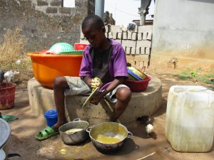 The Water Project:  Small Boy Cleaning Dishes