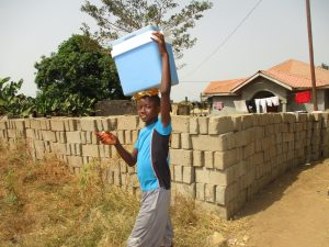 The Water Project:  Young Boy Selling Cold Water