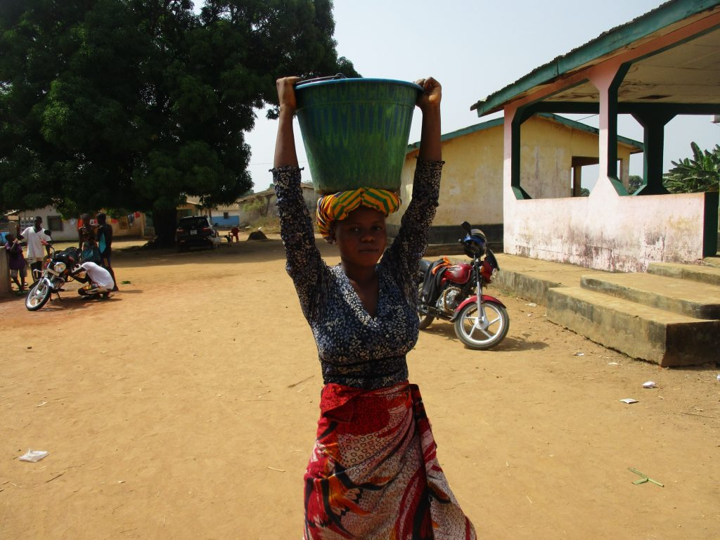 The Water Project : sierraleone20408-young-lady-carrying-water-1