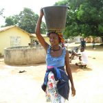 The Water Project: Lungi, Mahera, #5 MacAuley Street -  Young Lady Carrying Water