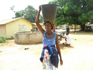 The Water Project:  Young Lady Carrying Water