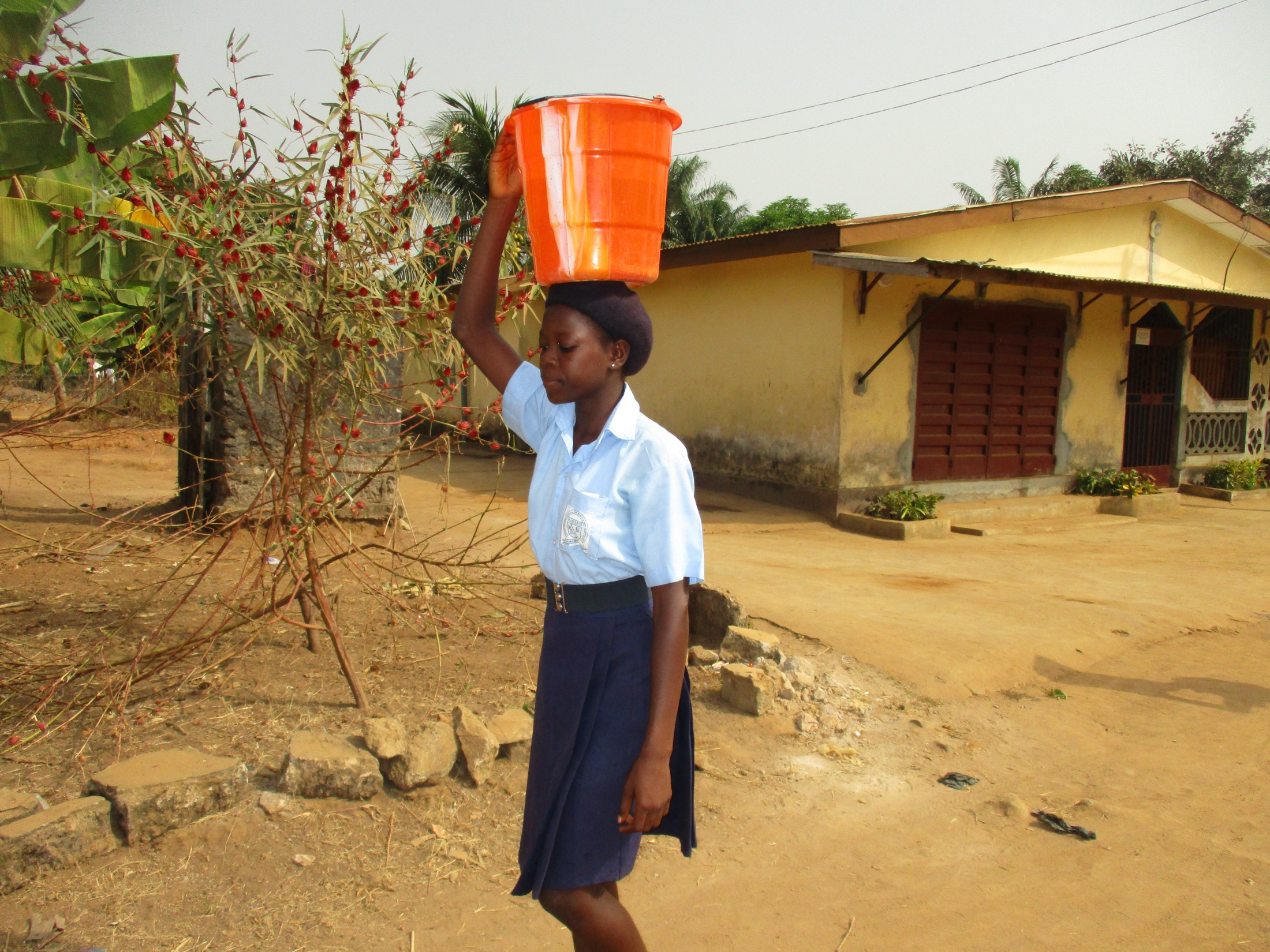The Water Project : sierraleone20409-student-carrying-water-3