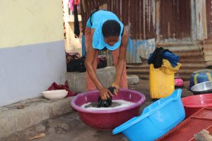 The Water Project:  Woman Laundring