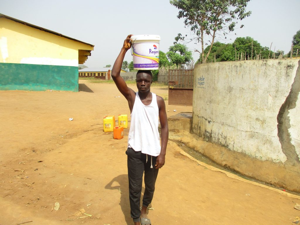 The Water Project : sierraleone20410-young-boy-carrying-water-3
