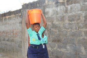 The Water Project:  Student Carrying Water