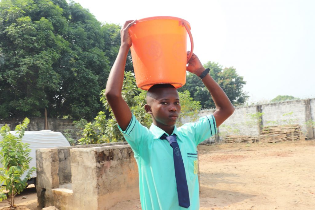The Water Project : sierraleone20411-student-carrying-water-3