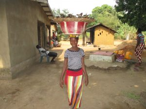 The Water Project:  Woman Selling Fish
