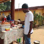 The Water Project: Lungi, Tardi, Khodeza Community School -  Young Man Selling Food