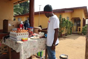 The Water Project:  Young Man Selling Food