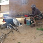 The Water Project: Kamasondo, Borope Village School -  Old Woman Cooking