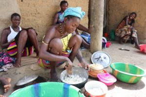 The Water Project:  Woman Dishing Food