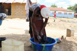 The Water Project:  Young Man Laundring