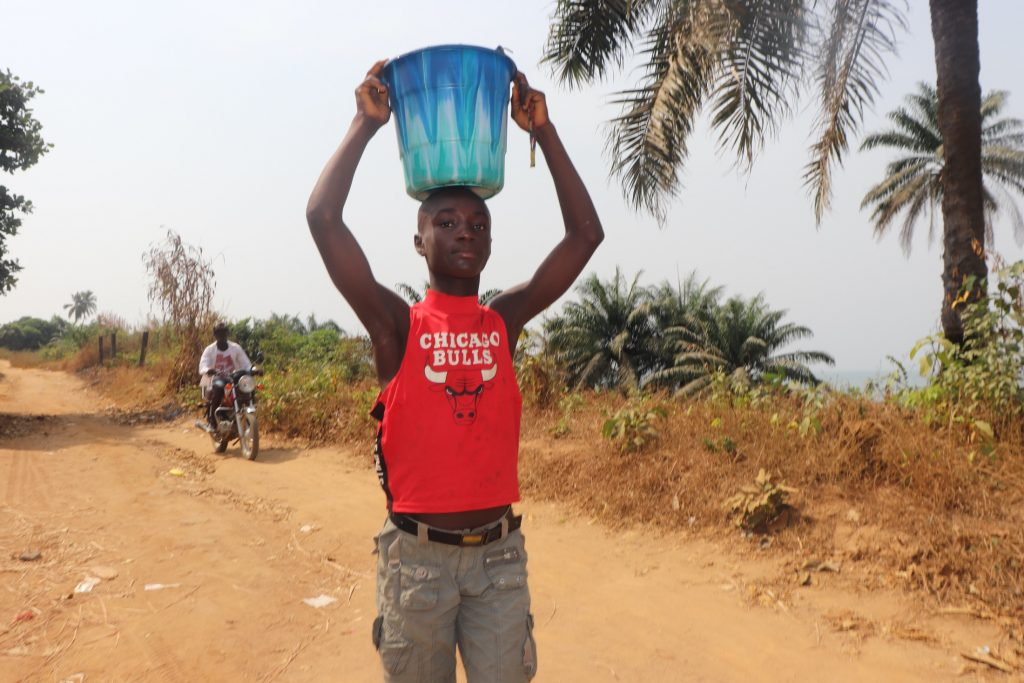 The Water Project : sierraleone20414-boy-carrying-water-1