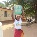 The Water Project: Lungi, Kamen, #22 Mission Road -  Old Woman Carrying Water