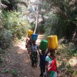 The Water Project: Lokomasama, Gbonkogbonko Village -  Community Members Carrying Water