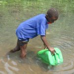 The Water Project: Lokomasama, Gbonkogbonko Village -  Small Boy Collecting Water