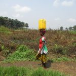 The Water Project: Lokomasama, Gbonkogbonko Village -  Woman Carrying
