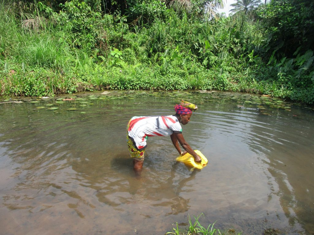 The Water Project : sierraleone20415-woman-collecting-water-3