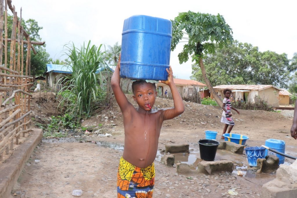 The Water Project : sierraleone20417-boy-carrying-water