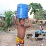 The Water Project: Kamasondo, Borope Village, Main Motor Rd. Junction -  Boy Carrying Water