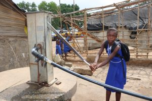 The Water Project:  Pupil Pumping Water