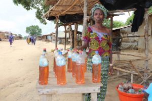 The Water Project:  Woman Selling Petrol By Liter