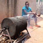 The Water Project: Kamasondo, Borope Village, Main Motor Rd. Junction -  Young Boy Roasting Groundnut In A Native Way