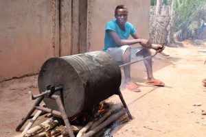 The Water Project:  Young Boy Roasting Groundnut In A Native Way