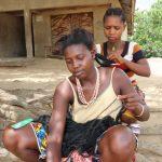 The Water Project: Kamasondo, Borope Village, Main Motor Rd. Junction -  Young Lady Braiding Hair