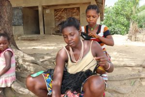 The Water Project:  Young Lady Braiding Hair