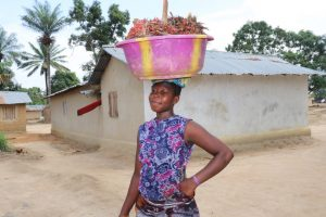 The Water Project:  Young Lady Carrying Palm Kanel