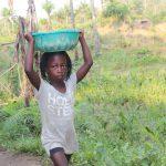 The Water Project: Lokomasama, Rotain Village -  Kid Carrying Water
