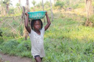 The Water Project:  Kid Carrying Water