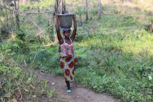 The Water Project:  Lady Carrying Water