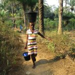 The Water Project: Lokomasama, Rotain Village -  Lady Carrying Water