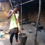 The Water Project: Lokomasama, Rotain Village -  Lady Pounding Pepper