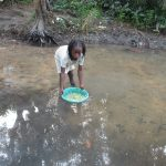 The Water Project: Lokomasama, Rotain Village -  Small Girl Collecting Water