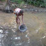 The Water Project: Lokomasama, Rotain Village -  Woman Collecting Water