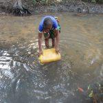 The Water Project: Lokomasama, Rotain Village -  Woman Fetching Water