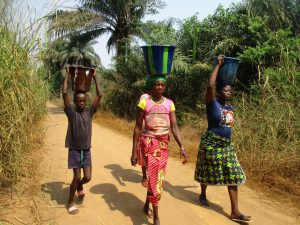 The Water Project:  Community Members Carrying Water