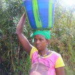 The Water Project: Lokomasama, Satamodia Village -  Woman Carrying Water
